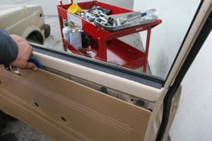 Work along the length of the door panel. Remove one fastener at a time. Vehicles that have seen a few less presidents will likely employ more space age materials then the vinyl covered pressboard panel seen here. Modern panels are just as easy to break.